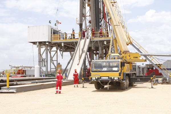 Ngamia 1 rig: Weatherford staff at the rig at Ngamia 1 exploration site in Turkana that is owned by Tullow Oil and Africa One.The firm has discover more oil at Twiga South 1 Photo Joseph Kariuki
