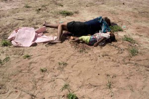 The bodies of Sally Margaret and her one-and-a-half-year-old daughter Patience Daniel lie in an open field after an attack in Kibusu village, Tana Delta, yesterday morning.Photo/Reuters