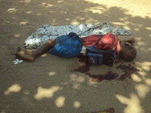 Is this death acceptable? A boy lies in a pool of blood after being hacked to death at Kibusu village in Tana River