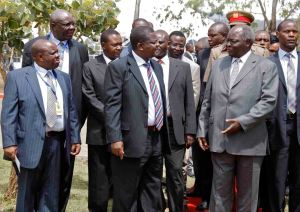 President Mwai Kibaki has a word with Finance minister Njeru Githae, Speaker of the Senate Hon. Ekwee Ethuro and other Governors during the official opening of the Induction Programme for Governors, Deputy Governors, County Assembly Speakers, Deputy Speakers, County-Co-ordinators and Interim Clerks at the Great Rift Valley Lodge in Nakuru County. Photo/PPS