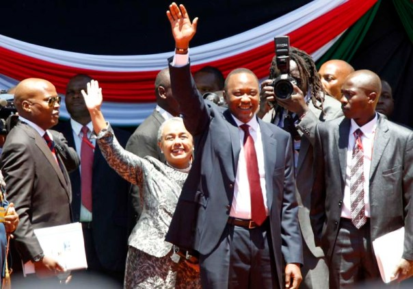 Kenya's President elect Uhuru Kenyatta waves to guests as he arrives for his official swearing-in ceremony at Kasarani Stadium in the capital Nairobi