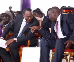 President Uhuru Kenyatta share a light moment with Deputy President William Ruto during the Labour day celebrations at Uhuru Park, Nairobi.Photo/PPS