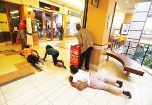 People scramble for safety at Westgate Mall after a terror attack by armed gunmen who shot at least 62 people dead