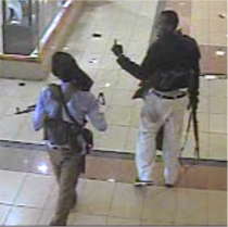 Two of the four gunmen walk casually inside Westgate mall after attacks on Saturday September 21 2013