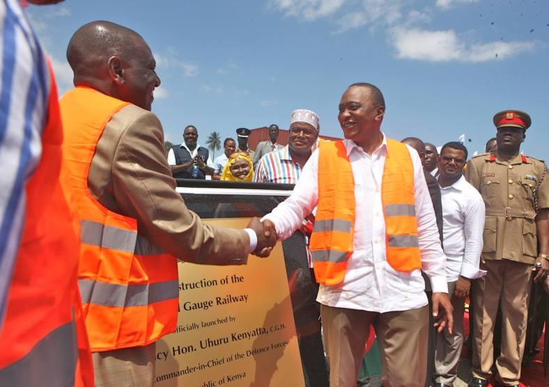 Deputy President Wiiliam Ruto congratulates President Uhuru Kenyatta after he officially launched the  construction of the Mombasa-Kamapala-Kigali-Juba Standard Gauge Railway in Changamwe, Mombasa County.