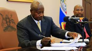 Uganda president Yoweri Museveni sign the anti gay bill into law at State House Entebbe